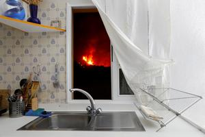 In pictures: Lava from Spain's La Palma volcano reaches ocean